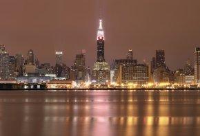 Обои New York, США, Нью-Йорк, мегаполис, здания, небоскребы, ночь, подсветка, огни, небо, река, отражение