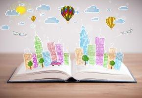 Обои открытая книга, город, здания, деревья, машины, самолет, облака