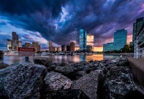 Обои USA, New Jersey, США, штат, Нью-Джерси, город, небоскребы, вечер, небо, закат, лодки, камни, берег, река